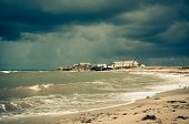 image of shacks  - Art toned image of fisherman shack with stormy skies - JPG