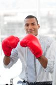 Successful Businessman Beating The Competion With Boxing Gloves