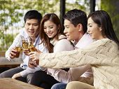 image of gathering  - young asian friends gathering chatting drinking beer - JPG
