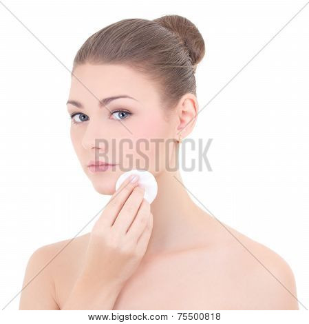 Portrait Of Young Beautiful Woman Cleaning Her Face Skin By Cotton Pad Isolated On White