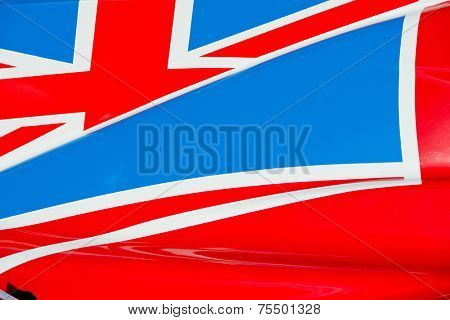 The colors and crest of the national flag of Great Britain painted on the body work of a race car
