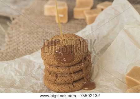 Sweet caramel candy with cookies and honey