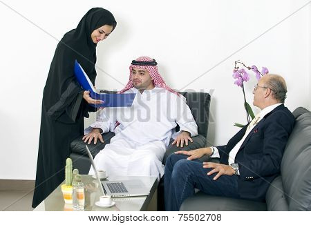 Arabian business people meeting with foreigner senior businessman in office
