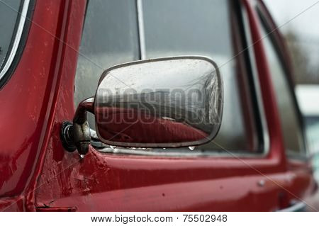 Rain Drops on a Car Mirror