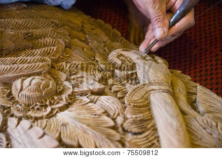 The View Of The Craftsman's Hand Using The Chisel To Engrave Thailand Traditional Design On Splat Fo
