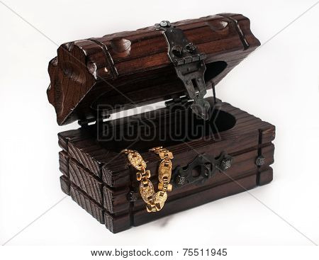 wooden jewelery box packed with accessories.Wooden treasure trunk with jewellry, isolated