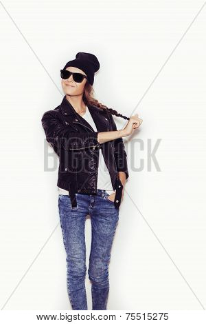 Woman In Sunglasses And Black Leather Jacket And Beanie