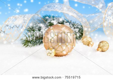 Christmas Balls With Ribbon On Snow, On Blue Background