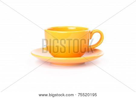 Orange mug with saucer on a white background