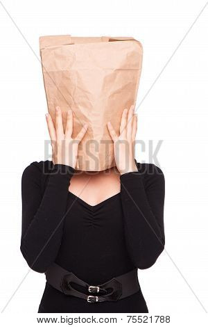 Woman with paper packet on head