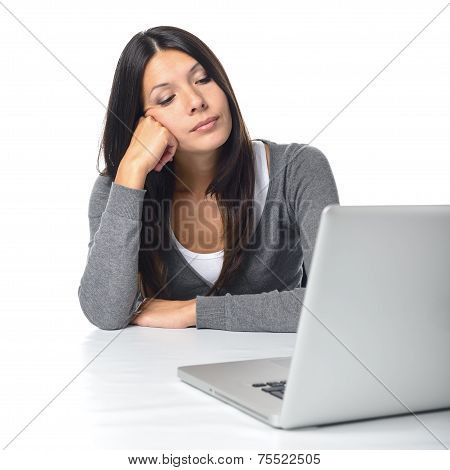 Bored Businesswoman Staring At Her Laptop Computer