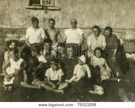 POLAND, CIRCA FIFTIES: Vintage photo of group of big multigenerational family outdoor