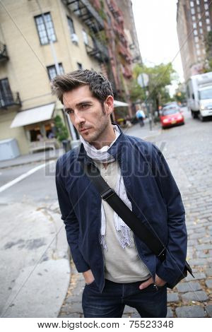 Casual guy crossing shopping street in Greenwich village