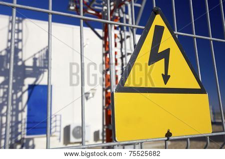 Warning sign high voltage with blue sky