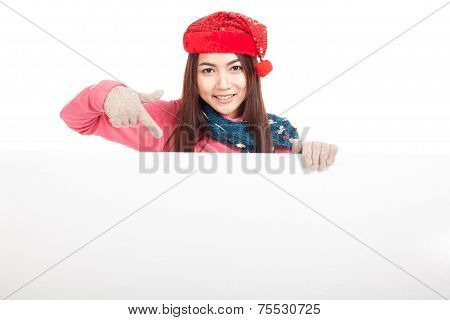 Asian Girl With Red Christmas Hat Point Down To Blank Sign