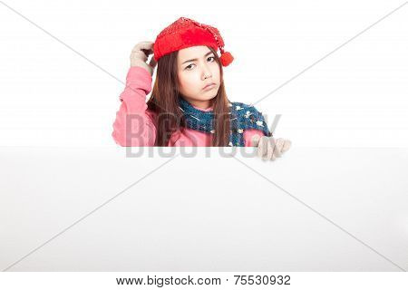 Asian Girl With Red Christmas Hat In Bad Mood Stand Behind A Blank Sign