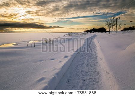 Walkway along the frozen waterfront of Summerside Harbor, Prince Edward Island, Canada.