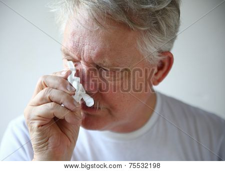 Senior Man With Runny Nose