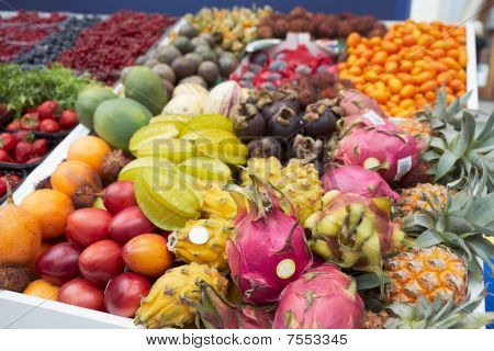 Various Tropical Fruits On Market Stall