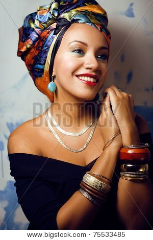 beautiful bright African woman with creative make up, shawl on head like Cuban closeup