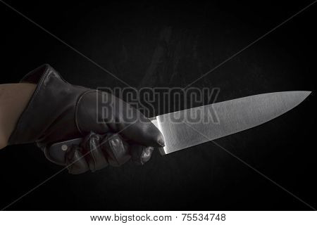Hand In Leather Gloves Holding Knife