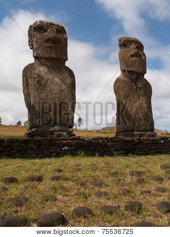 Pair Of Moai Against Blue Sky