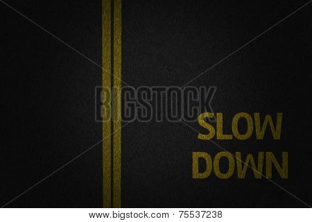 Slow Down signs on the road