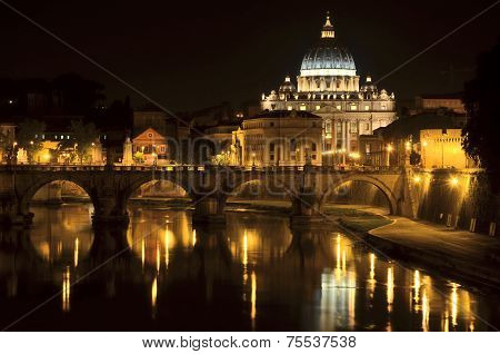 Monumental St. Peters Basilica over Tiber by night in Rome, Italy
