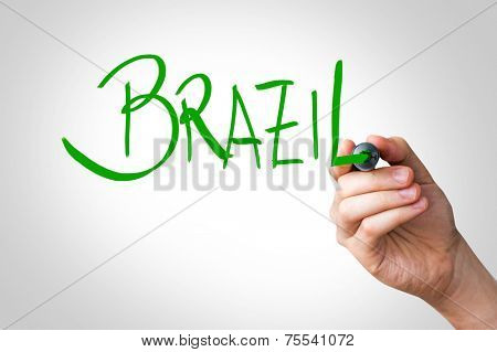 Hand writing with a green mark on a transparent board - Brazil