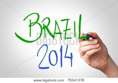 Hand writing with a green and blue mark on a transparent board - Brazil 2014