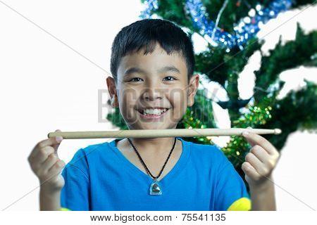Asian Kid Hold Drum Stick
