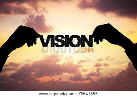 Silhouette Businessman's Hands Holding Vision During Sunset