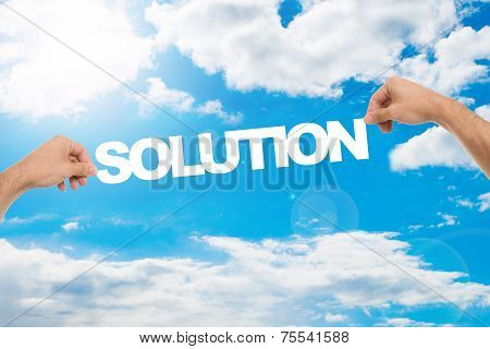 Man's Hands Holding Solution Against Cloudy Blue Sky