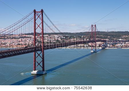 The 25 De Abril Bridge Over River Tejo