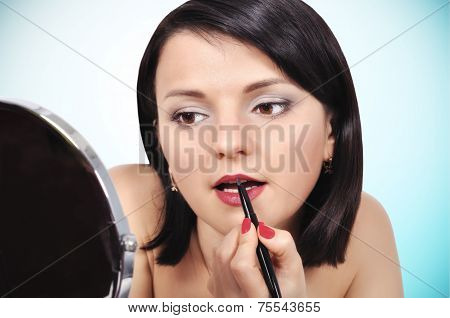 Girl Applying Lipstick On Lips