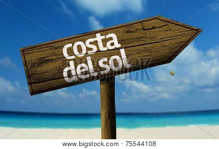 Costal del Sol wooden sign with a beach on background