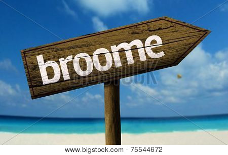 Broome, Australia wooden sign with a beach on background