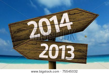 2013, 2014 wooden sign with a beach on background