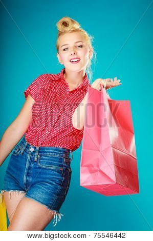 Pinup Girl With Shopping Bag Buying Clothes. Sale