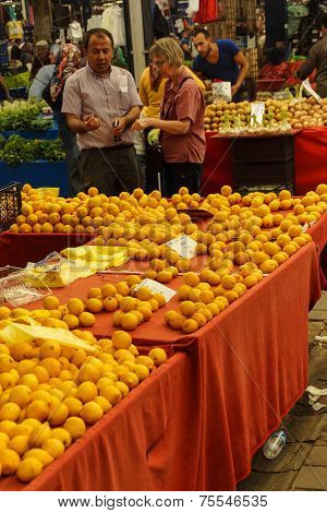 Shoppers Buy Oranges