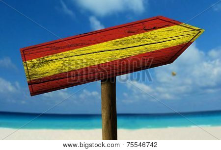 Spain flag wooden sign with a beach on background - Europe