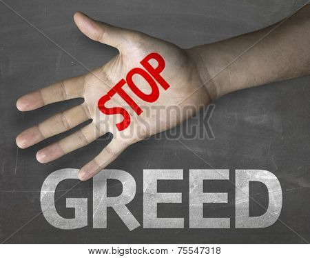 Educational and Creative composition with the message Stop Greed on the blackboard
