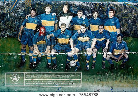 BUENOS AIRES, ARGENTINA - JAN 12: Boca Juniors team painted on the street wall on January 12, 2011 in Argentina, Buenos Aires. Boca Juniors is the most famous soccer team in Argentina.