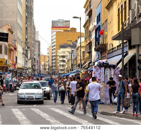 SAO PAULO, BRAZIL - AUGUST 31: People walks along the 25 March area in August 31, 2013 in Sao Paulo, Brazil. 25 March Area, is a popular commerce region near the center of S�?�£o Paulo, Brazil.