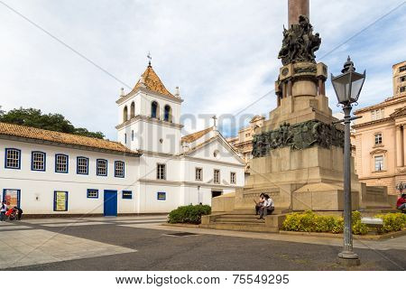 SAO PAULO, BRAZIL - AUG 3: Patio do Colegio on August 3, 2013 in Sao Paulo, Brazil. Patio do Colegio is the name given to the historical Jesuit church and school in the city of Sao Paulo.