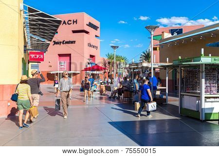 LAS VEGAS - JULY 27: Unidentified people shop at Premium Outlet on July 27, 2013 in Las Vegas. Premium Outlet are located across the United States and offer discounts and special promotions