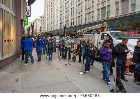 SAN FRANCISCO, CA - SEPTEMBER 20: People queuing in Stockton Street to buy the new iPhone 5S and C on September 20, 2013 in San Francisco, CA. The iPhone 5S and C are the last model launched by Apple