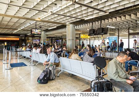 SAO PAULO, BRAZIL - SEP 24: Tourists wait in front of gate 20 in Guarulhos Airport on September 24, 2013 in Sao Paulo, Brazil. Gru Airport is located in Sao Paulo and is the main airport in Brazil
