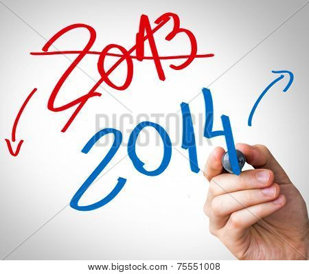 Hand writing with a red and blue mark on a transparent board show that 2013 year is over and 2014 are coming.