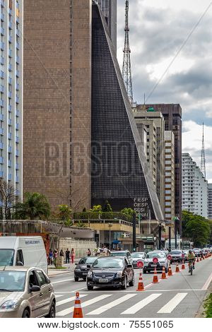 SAO PAULO, BRAZIL - OCT 13: Paulista Avenue on October 13, 2013, in Sao Paulo, Brazil. Paulista is one of the most important avenues in Sao Paulo with 2.8 kilometer of thoroughfare.